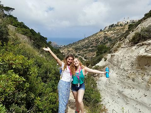 Two students pose on a hike during a Birthright Israel trip.
