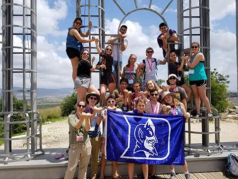 Students make Blue Devil horn hand gesture during Birthright Israel trip.
