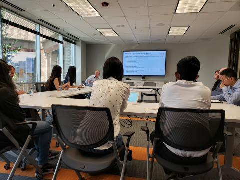 students at Conduent site visit in a meeting room watching apresentation.