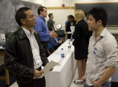Alum and student talking at a mixer